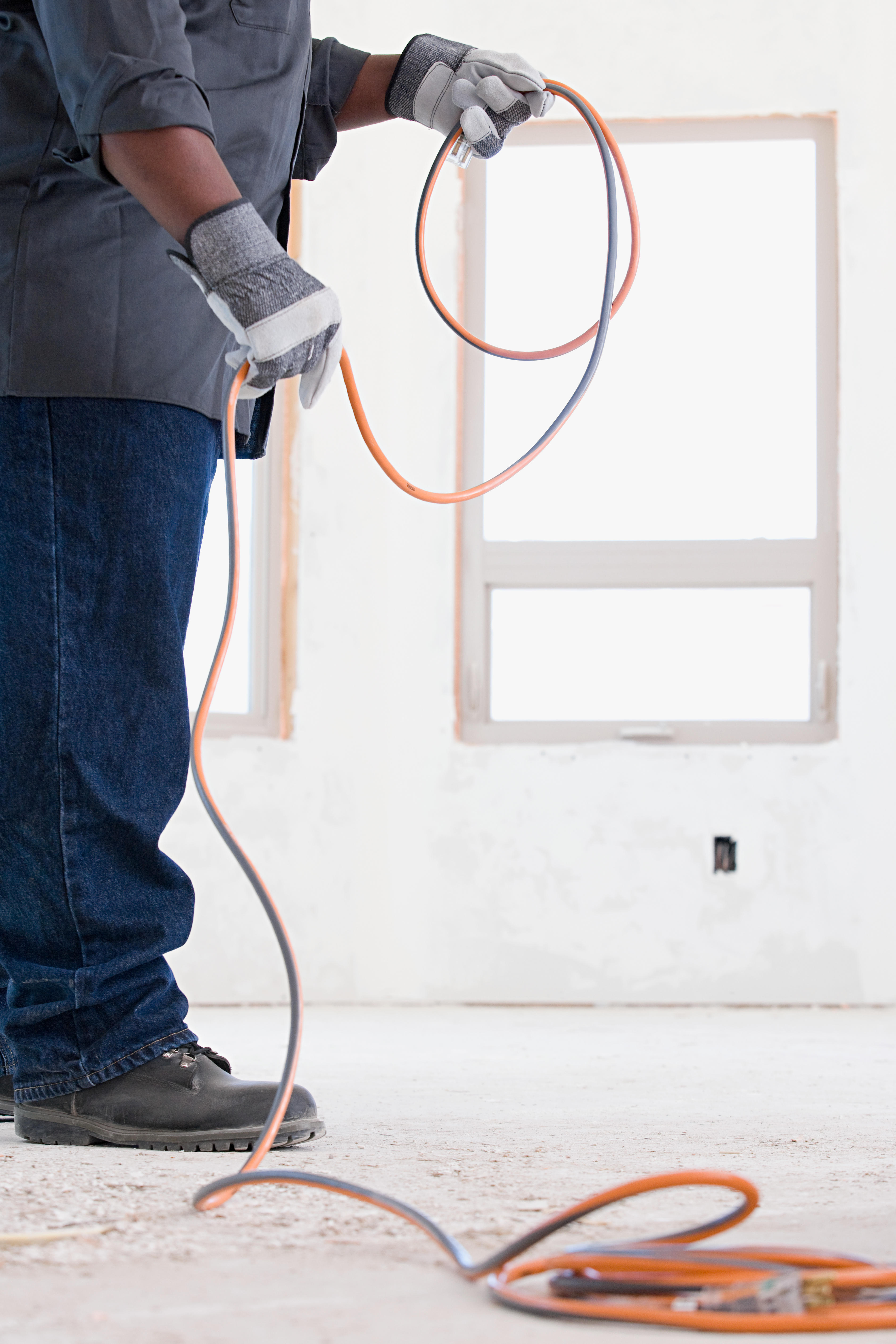 Electrician Holding Electrical Cable